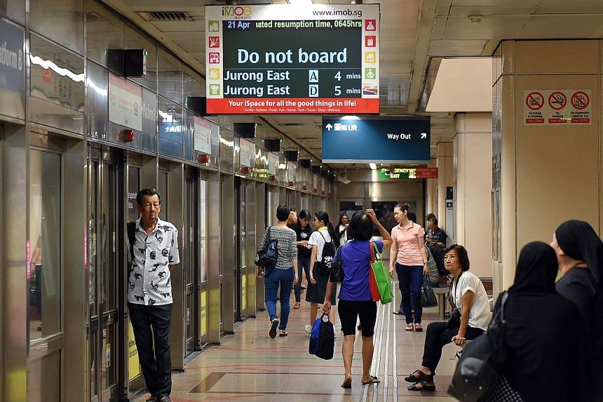 Passengers waiting for train services along the North-South Line to resume at Raffles Place station yesterday at 6.30am. Service was restored at around 6.50am. On the North East Line, service on part of the line was affected just after 11am, for abou