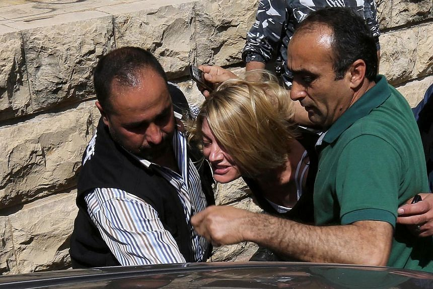 Lebanese policemen (above) escorting TV presenter Tara Brown from a courthouse to Baabda Prison for women near Beirut on Monday. Ms Brown and her crew were accused of helping Ms Faulkner (right) in a botched kidnapping of the latter's two children.