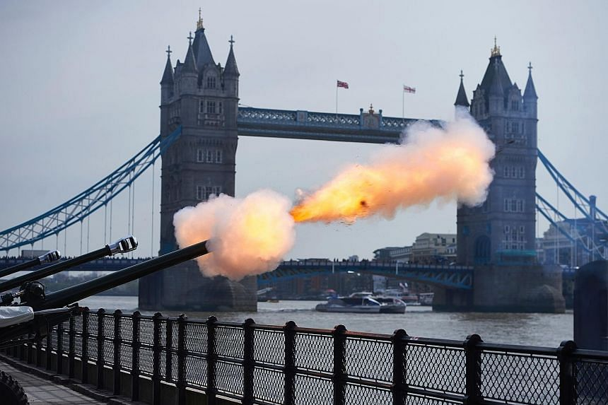 London's Tower Bridge was the backdrop for one of the two military gun salutes in the British capital to mark the Queen's birthday. The other was at Hyde Park. The Queen greeting well-wishers outside Windsor Castle yesterday. She has been on the thro