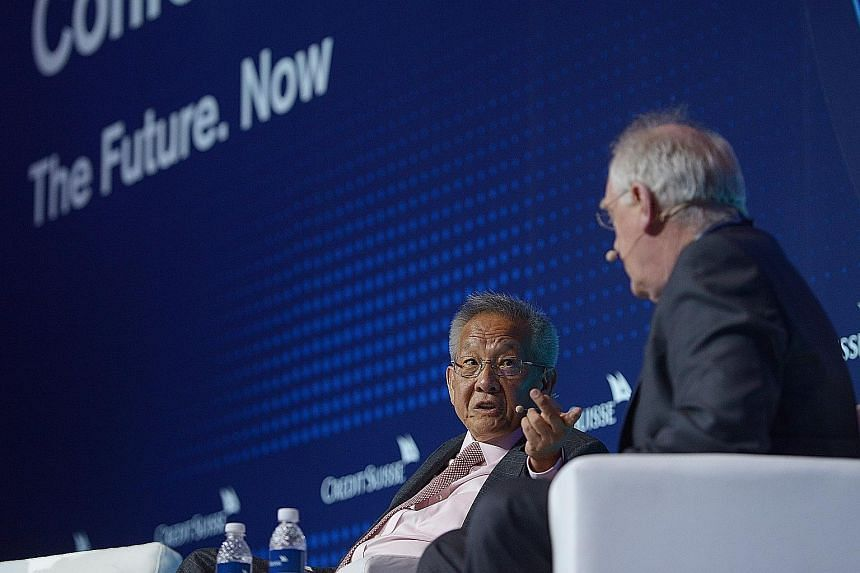 Former GIC chief investment officer and Avanda founder Mr Ng (left) and Credit Suisse senior adviser for investment, strategy and research Mr Parker were panellists at the fourth annual Credit Suisse Global Megatrends Conference yesterday.
