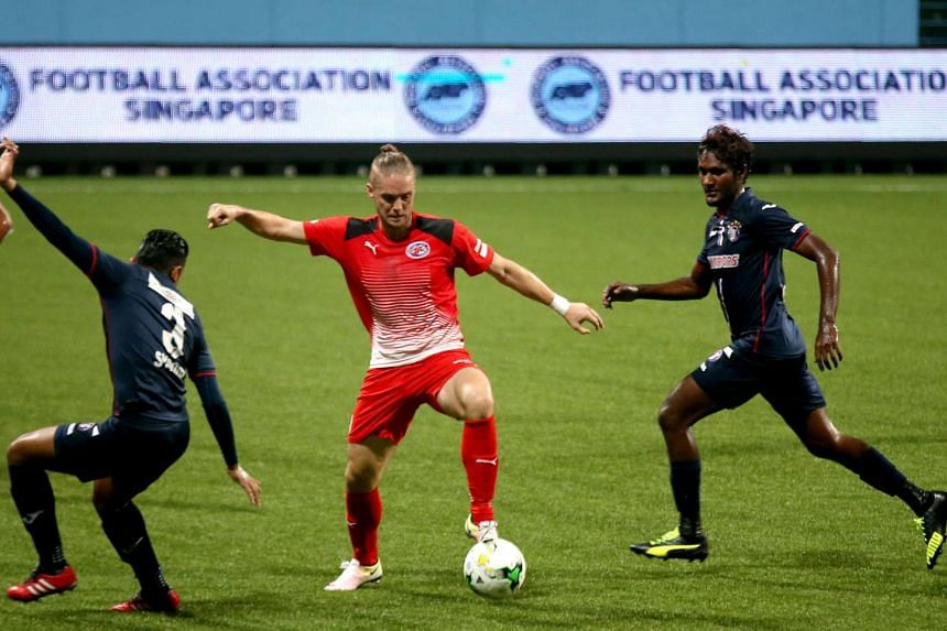Home United (in red) claimed a 2-1 win over Warriors FC at the Jalan Besar Stadium on Friday (April 22).