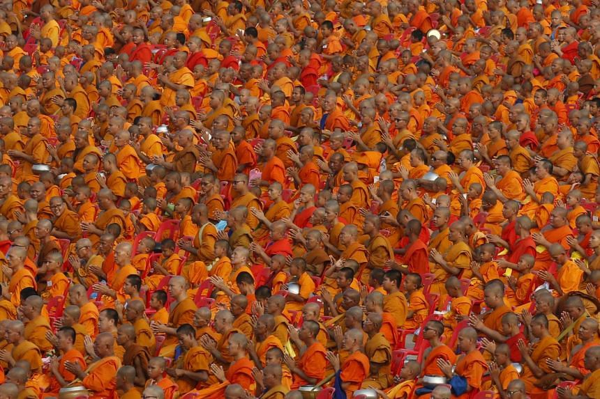 Over 100,000 Buddhist monks and novices gather to receive alms at Wat Phra Dhammakaya temple in Pathum Thani, outside Bangkok.