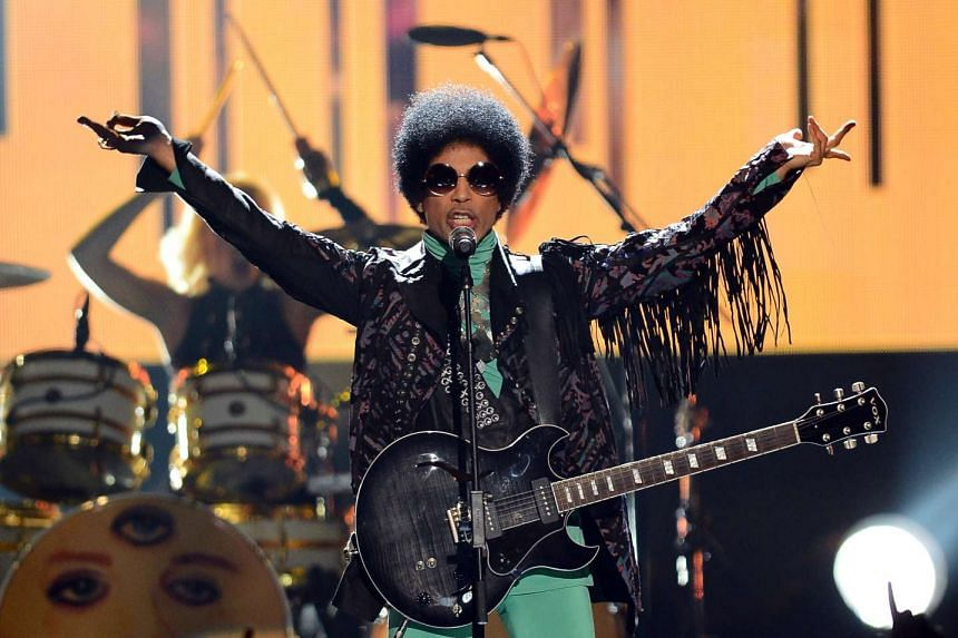 Prince rocks out during the 2013 Billboard Music Awards in Las Vegas.