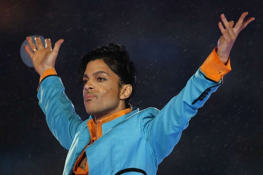 Prince performs during the halftime show of the NFL's Super Bowl XLI football game in Miami, Florida on Feb 4, 2007