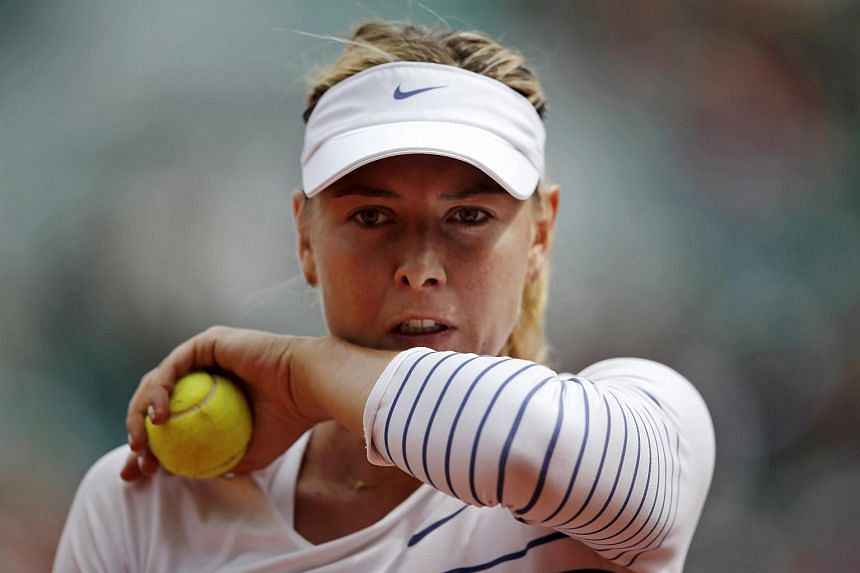 Russia's Maria Sharapova wipes her face during her match against Lucie Safarova of the Czech Republic during the French Open, on June 1, 2015.