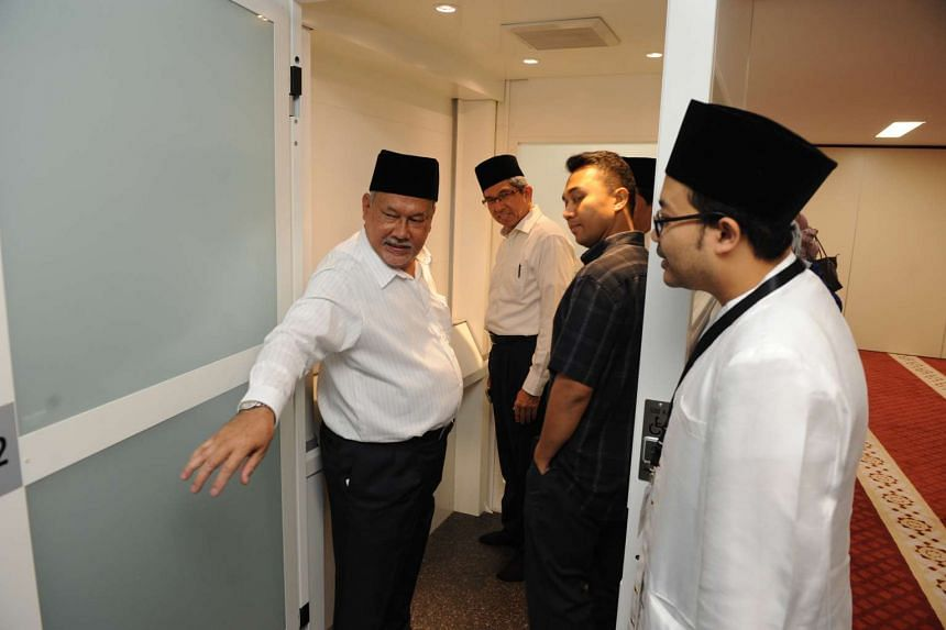 Dr Yaacob Ibrahim testing out the newly-built lift at the Al-Falah Mosque.