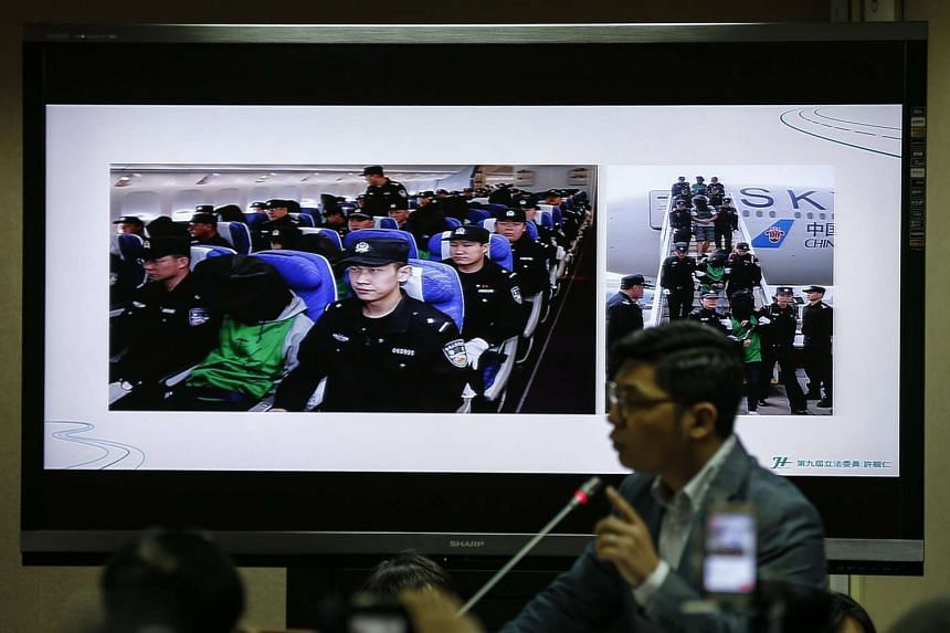 Pictures of Taiwanese nationals deported from Kenya to China are displayed on a monitor during legislator's inquiry on into incident in Taipei, Taiwan, on April 14, 2016.