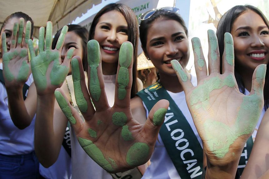 Women participating in a hand painting activity to mark Earth Day in Las Pinas City, Philippines, on April 22.