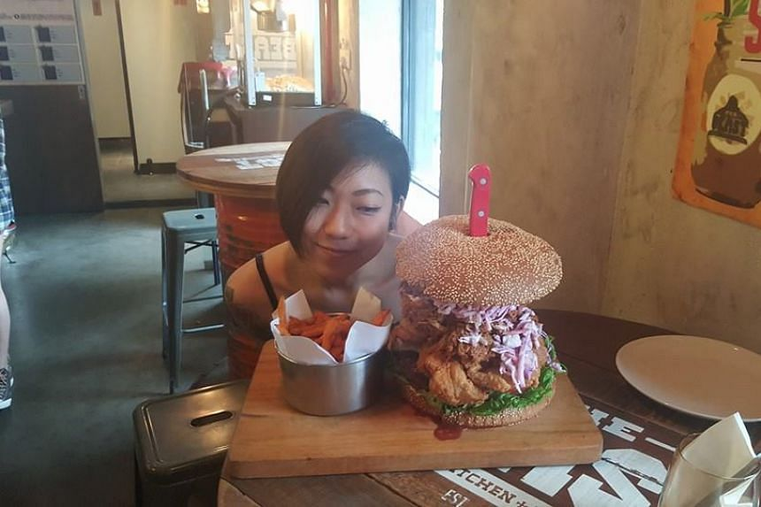 Ms Thomasina Ow before she tackled a 3.2kg burger with fries.