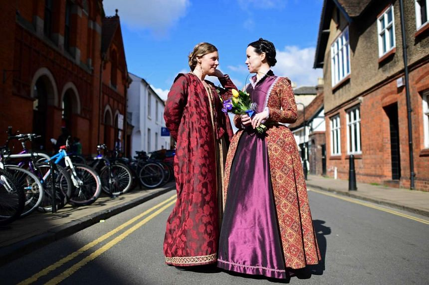 Two women in costume preparing for the parade marking the 400 years since the death of William Shakespeare, in Stratford-upon-Avon, on April 23, 2016.
