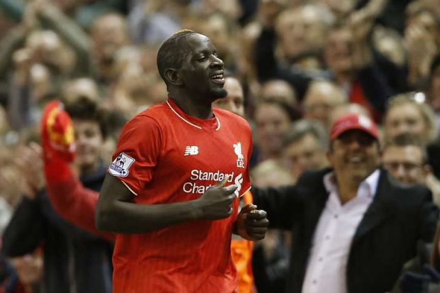 Mamadou Sakho celebrates after scoring the second goal for Liverpool in a football match against Everton on April 20, 2016.