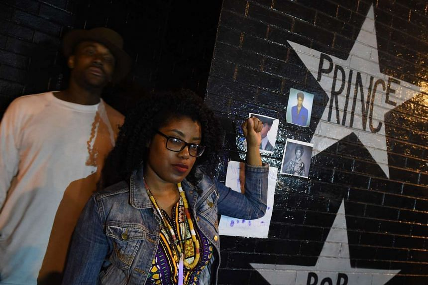 Fans pay their respects outside the First Avenue club where music legend Prince who has died suddenly at the age of 57, got his first breakthrough at the start of his musical career in Minneapolis, Minnesota, on April 22, 2016.