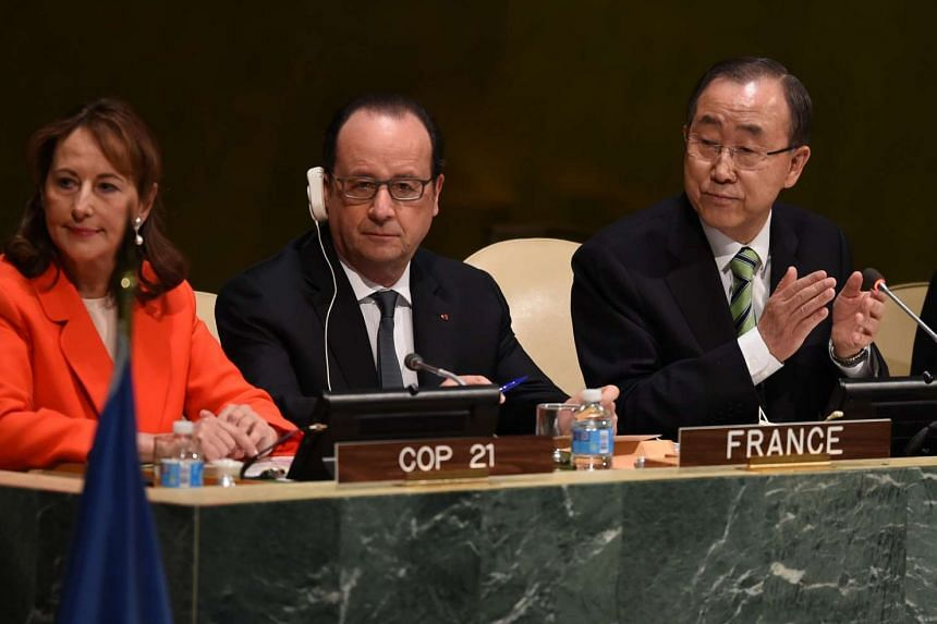 (From left) Ségolène Royal, Francois Hollande, President of France, and UN Secretary General Ban Ki-moon,attend the high level signature ceremony for the Paris Agreement at the United Nations General Assembly Hall April 22, 2016 in New York.