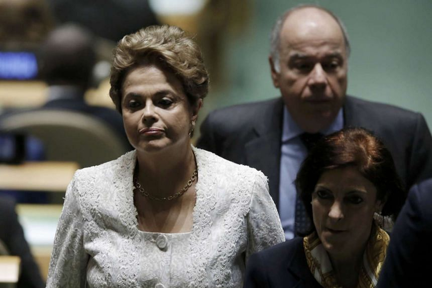 Brazilian President Dilma Rousseff walks down an aisle before the Paris Agreement signing ceremony on climate change in New York.