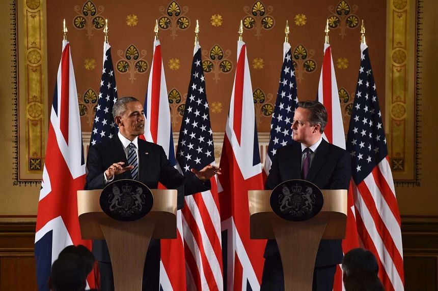 US President Barack Obama (left) and Britain's Prime Minister David Cameron (right) arrive for a press conference at the Foreign and Commonwealth Office in central London on April, 22, 2016 following a meeting at Downing Street.