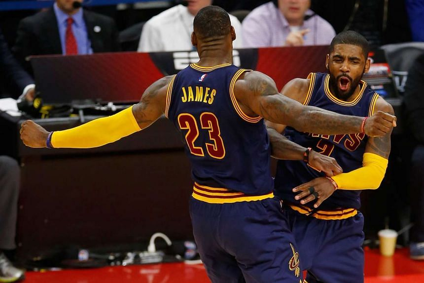 Kyrie Irving (right) of the Cleveland Cavaliers celebrates his fourth quarter three pointer in Game 3 of the NBA Eastern Conference series.