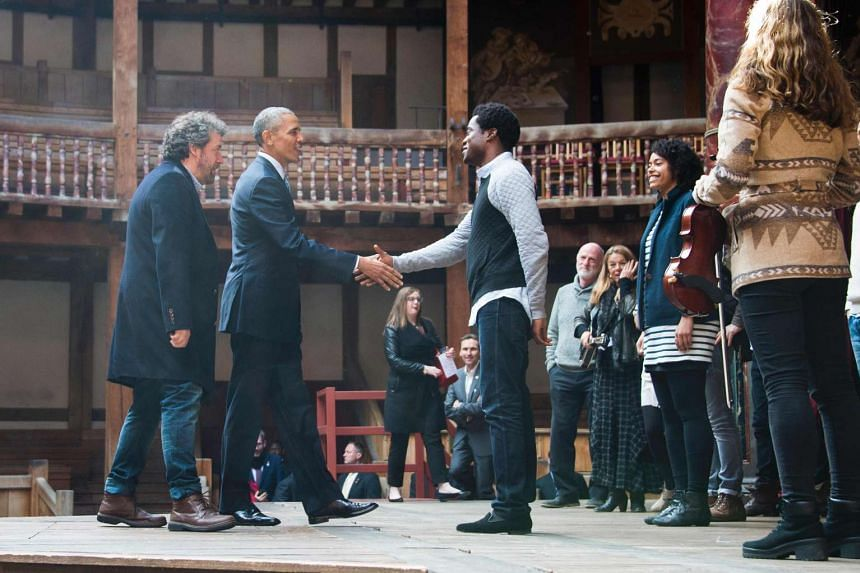 US President Barack Obama (second from left) shakes hands with actors after watching part of Shakespeare's Hamlet while touring the Globe Theatre in London, April 23, 2016.