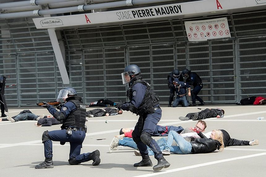 Police officers taking part in a mock terror attack in Lille on Thursday as part of the security measures set for the upcoming Euro 2016 football championship in France. The French government is seeking a new extension of a state of emergency to cove