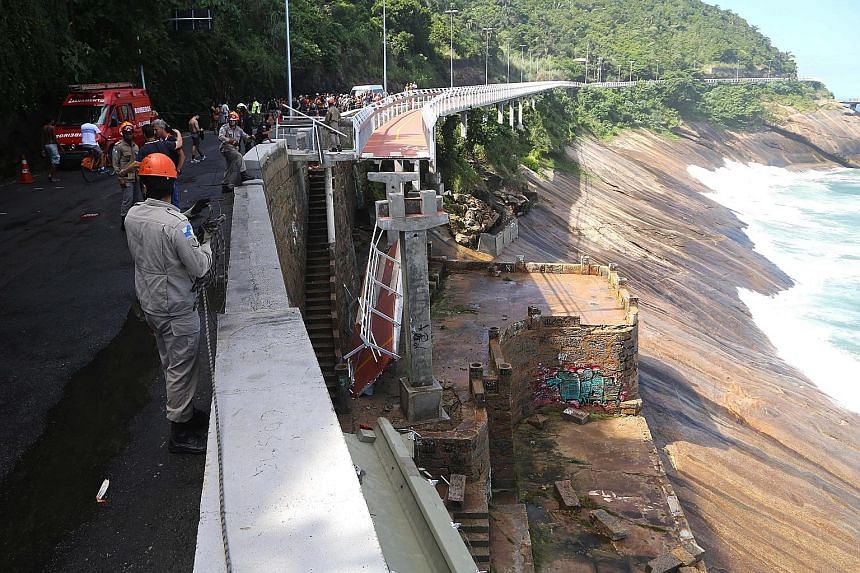 Emergency personnel at work after a section of a cycling path built for the upcoming Olympic Games 2016 in Rio de Janeiro, Brazil, collapsed earlier this week. Two people were killed when strong waves caused a 50m section of the path to collapse.