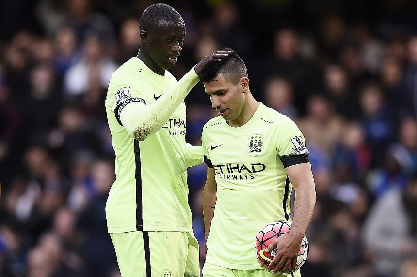 Yaya Toure celebrates with Sergio Aguero after the Argentinian scored all the goals in their 3-0 thrashing of Chelsea last Saturday at Stamford Bridge. His strike against Newcastle on Tuesday took him to 22 league goals this season, two behind Spurs'
