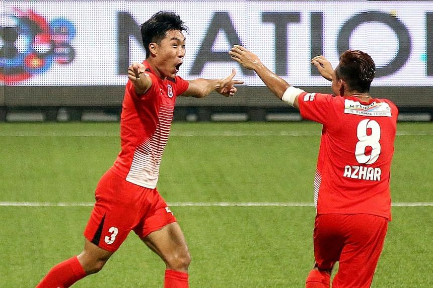 Song Ui Young being greeted by team-mate Azhar Sairudin after the South Korean midfielder scored Home United's first goal in the 20th minute.