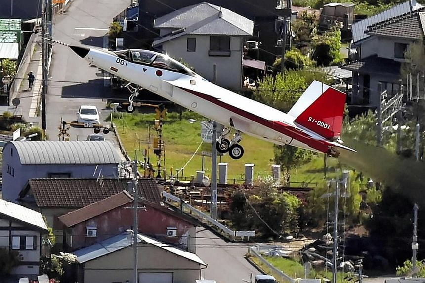 The X-2 taking off in Japan's Aichi prefecture yesterday. With its successful test flight, Japan joins the US, Russia and China in having developed and flown manned stealth jets.