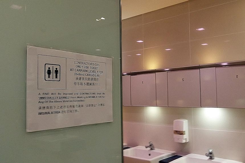 The mall's management has put up signs outside all the men's toilets. Construction workers who break the rule face a fine and will be barred from working in the mall. They are allowed to use only a toilet in the carpark on the fifth floor.