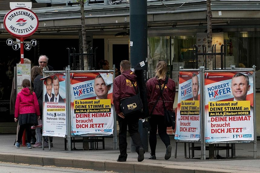 Election campaign posters of Austrian presidential candidate Norbert Hofer of the Freedom Party in Vienna on Tuesday. He is among three wild cards in the ballot tomorrow.