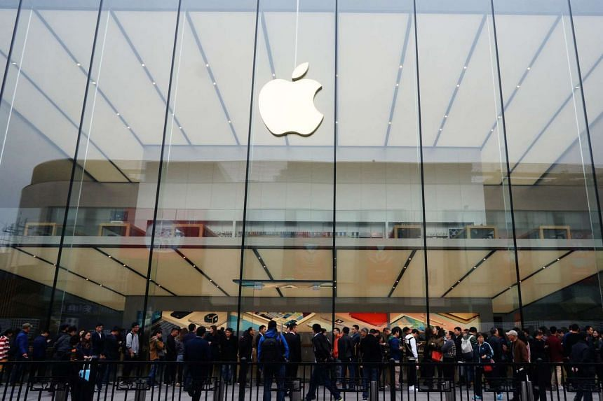 People line up outside an Apple store in Hangzhou, China on March 31, 2016.