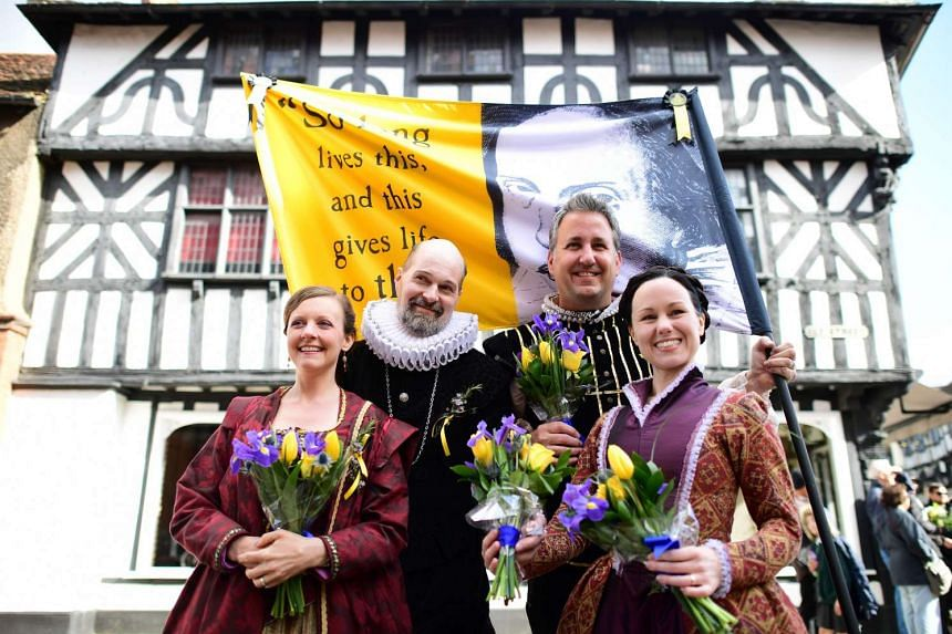 Members of Kentucky Shakespeare, the oldest free Shakespeare festival in the US, prepare for the parade marking 400 years since the death of William Shakespeare, in Stratford-upon-Avon, on April 23, 2016.