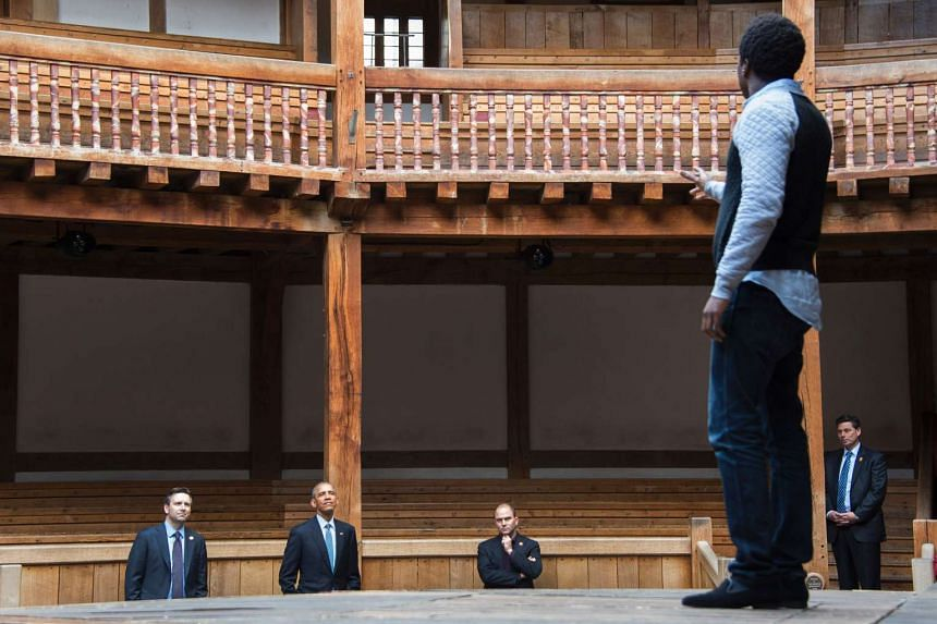 US President Barack Obama (second from left), White House Press Secretary Josh Earnest (left) and Deputy National Security Adviser for Strategic Communication Ben Rhodes watch as actors perform Shakespeare's Hamlet at the Globe Theatre in London, Apr