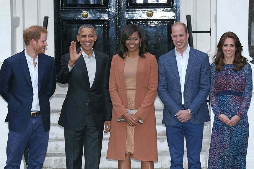 US President Barack Obama (second from left), First Lady Michelle Obama (centre) Britain's Prince William, Duke of Cambridge (second from right), his wife Catherine, Duchess of Cambridge (right) and Britain's Prince Harry (left) posing for a photogra