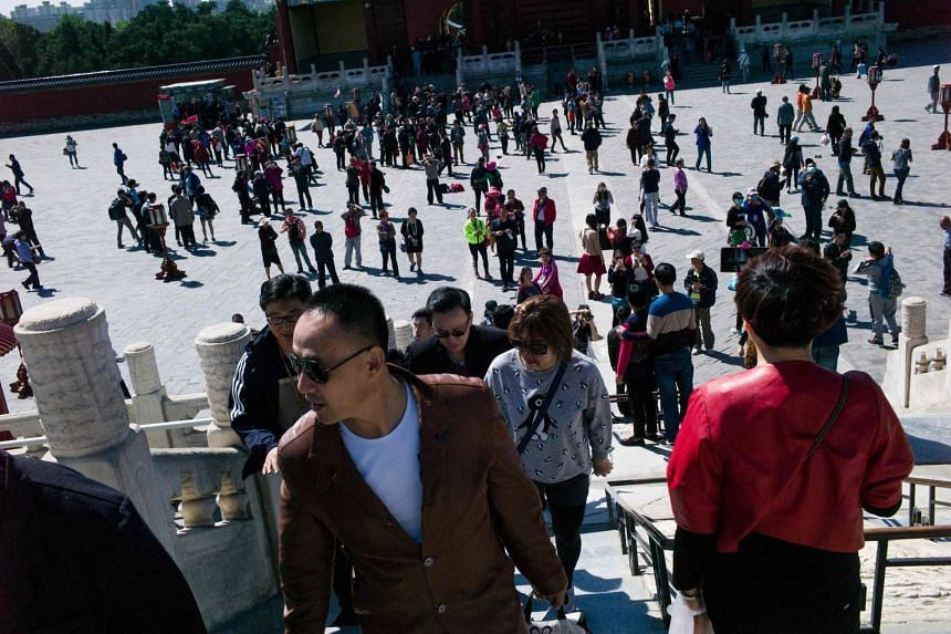 Tourists visiting the Temple of Heaven in Beijing on April 18, 2016.