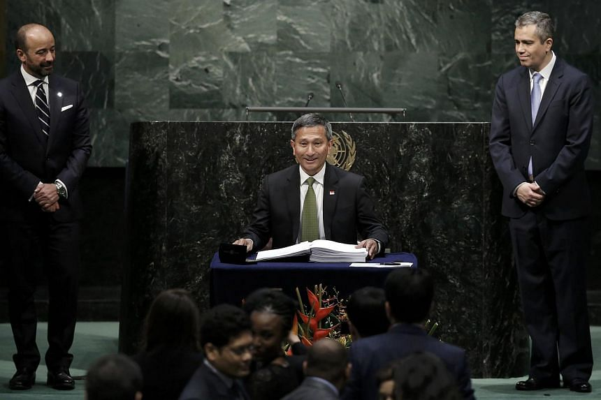 Minister for Foreign Affairs Vivian Balakrishnan signing the Paris Agreement on climate change at the United Nations Headquarters in New York.