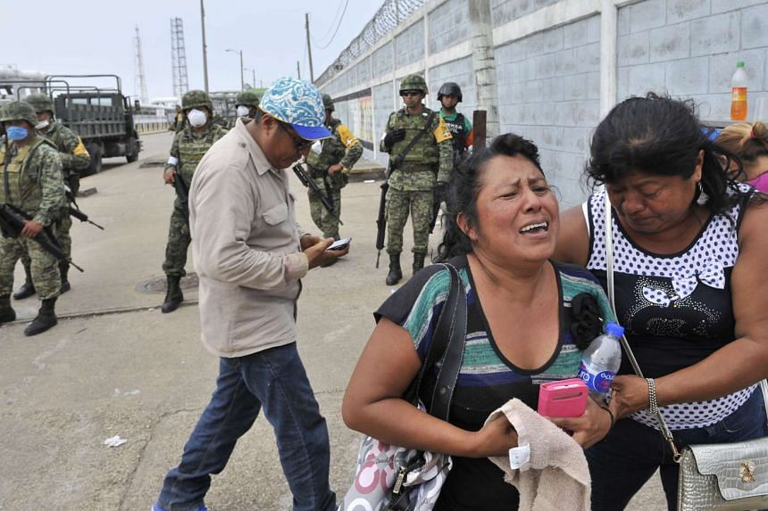 Relatives waiting for news of their loved ones at Pemex's petrochemical plant in Mexico, a day after the blast, on April 21.
