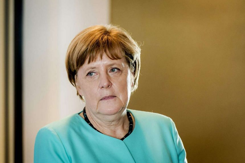 German Chancellor Angela Merkel is pictured during a visit to the chip equipment manufacturer ASML in Veldhoven, on April 21, 2016.