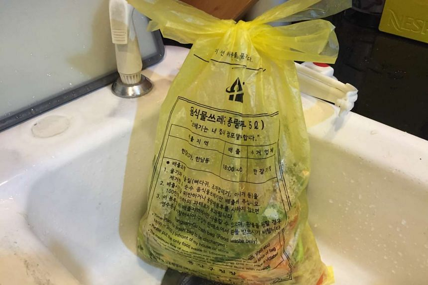 Households have to buy bags like this yellow one (2,100 won for a pack of 10 three-litre bags) to put food waste. When full, it needs to be taken outside the apartment building and left at the main gate for the garbage truck to collect.