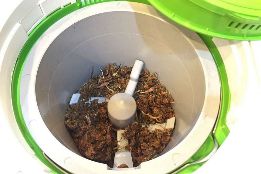 After photo of the Smart Cara food waste processor after grinding a full bucket of orange peel, leftover rice, rotten vegetables and soup scraps into a dried mixture that can be used as fertiliser.