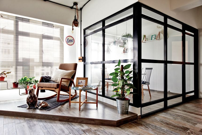 Space-loving couple Kenny Ren and Ruby Chong closed off their activity room (above) with tempered glass so that the living room still enjoys an open look.