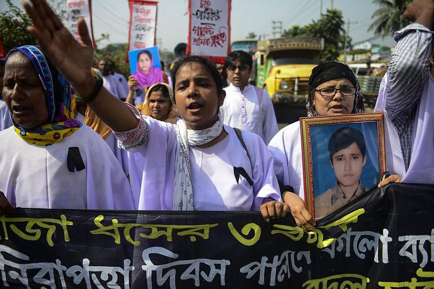 Bangladeshi activists and relatives of victims of the Rana Plaza building collapse protest at the site where the building once stood in Savar, Dhaka on April 24, 2016.