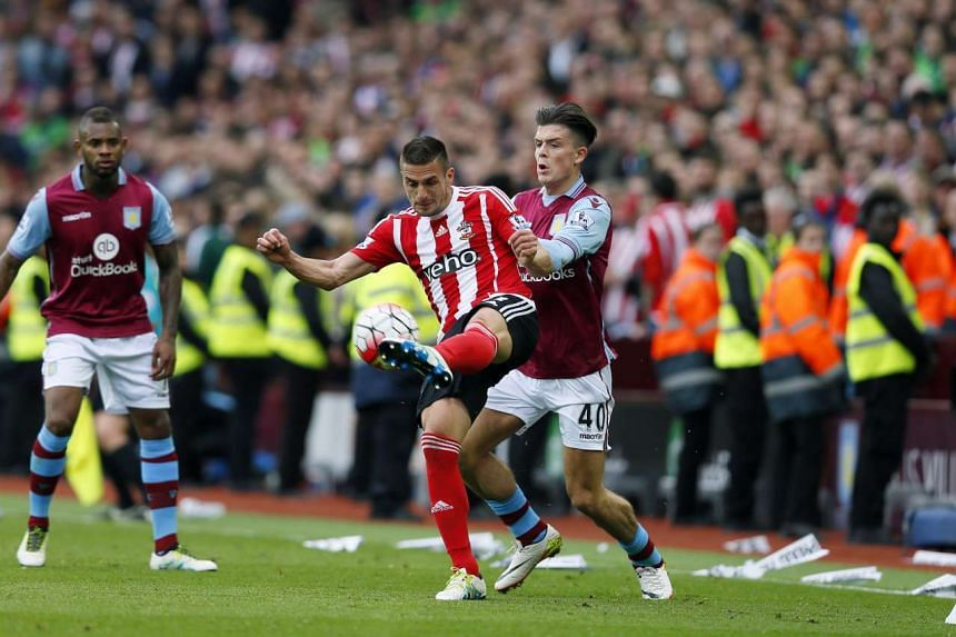 Southampton's Dusan Tadic in action with Aston Villa's Jack Grealish at the Barclays Premier League in  Villa Park on April 23, 2016.