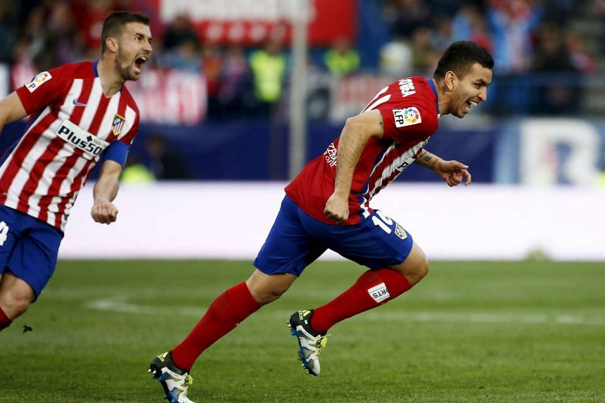 Atletico Madrid's Angel Correa (right) celebrates his first goal during the match.