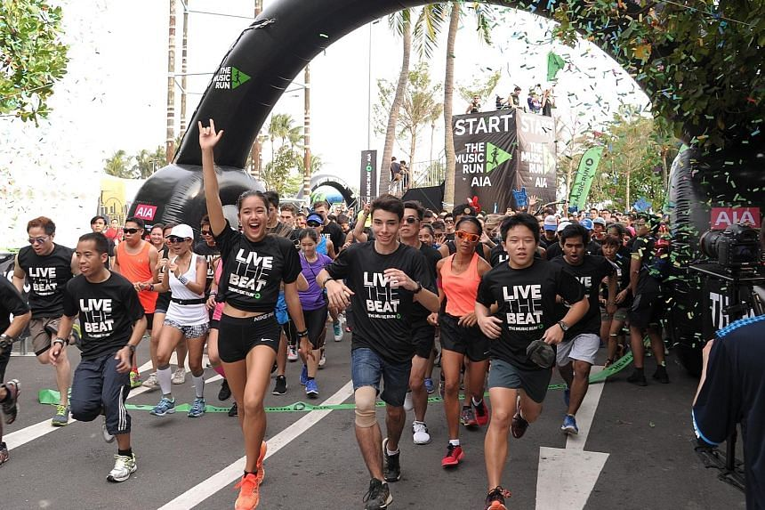 A crowd of 10,000 turned up at Sentosa yesterday afternoon to keep fit through a run, while grooving to their favourite beats. Over 120 concert-quality speakers lined the 5km route of The Music Run, blasting out tunes such as Demons by Imagine Dragon