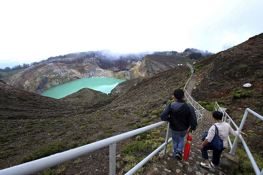 Visitors make their way towards a lake on Kelimutu volcano, a popular tourist site, near Ende on the Flores archipelago.
