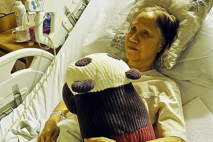 (Left) Ms Chan in Singapore General Hospital with her stuffed panda Popo and (above) in the award-winning film Be With Me. Her zest for life had inspired film-maker Eric Khoo.
