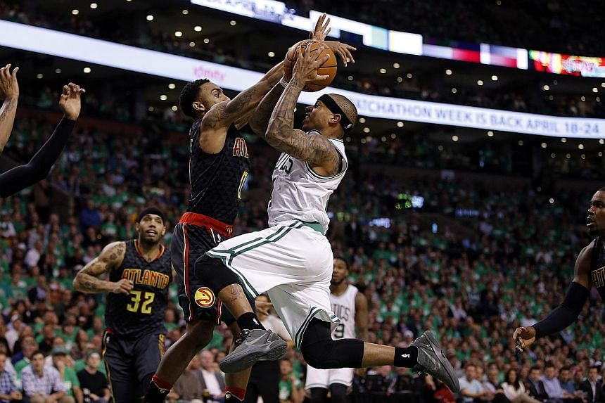 Boston guard Isaiah Thomas going up for a shot, as Atlanta guard Jeff Teague blocks him in Game 3 of their NBA Eastern Conference first-round play-offs at TD Garden. Thomas enjoyed a career-high 42 points in the 111-103 victory.