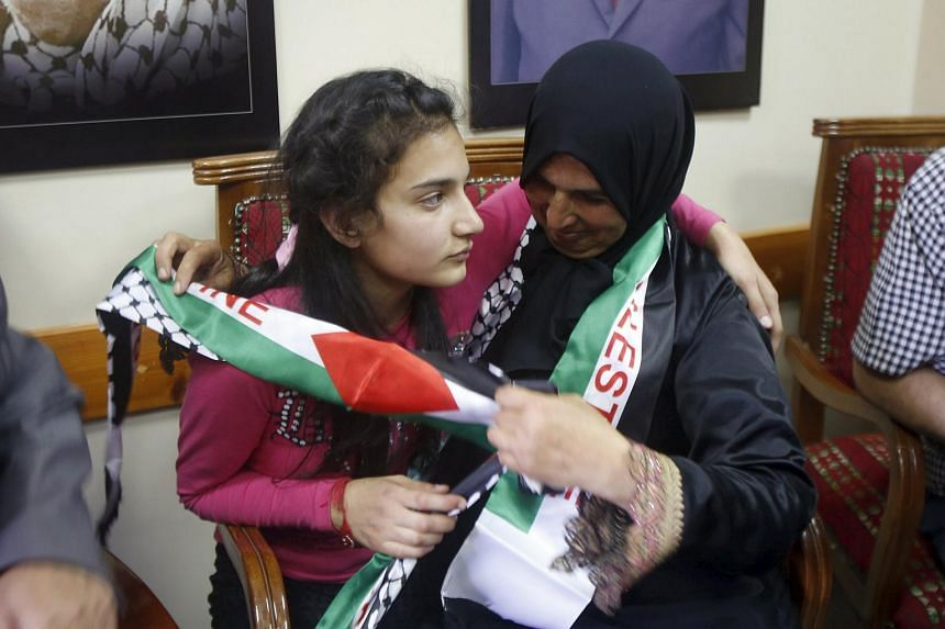 Palestinian girl Dima al-Wawi (left) hugging her mother after being released from Israeli custody, near Tulkarm, on April 24, 2016.