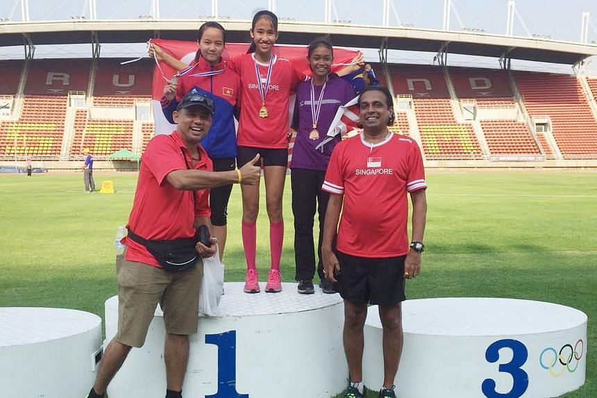 Tia Rozario (centre) won the gold medal in the long jump with a distance of 5.86m.