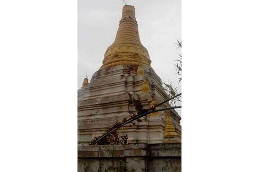 A pagoda's umbrella lies destroyed after a freak hail storm, in Khin-U Township, Sagaing Region.