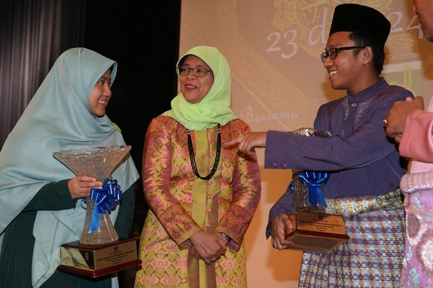 Mr Ahmad Daniyal Bin Mohd Rizal (right) and Ms Nurul 'Izzah Binti Kahmsani (left) speak to guest-of-honour Speaker of Parliament Madam Halimah Yacob (centre) at the National Quranic Recitations Competition 2016 on April 24, 2016.